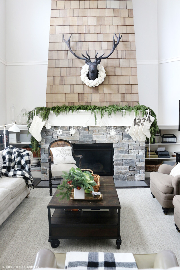 Christmas Home Tour / fireplace with garland and stockings / jones design company
