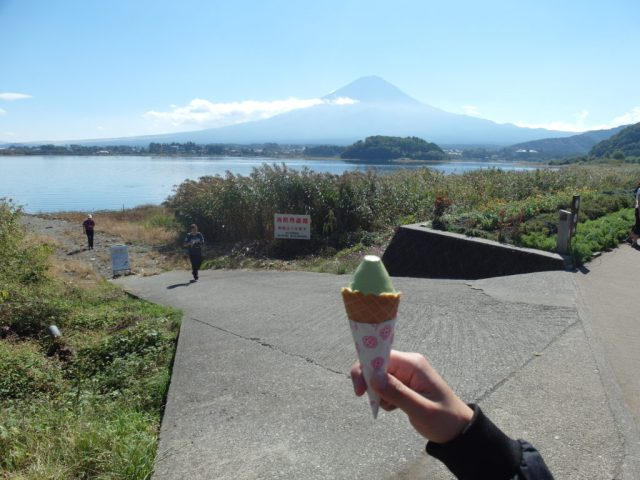Green tea Mount Fuji ice cream with Mount Fuji in the background