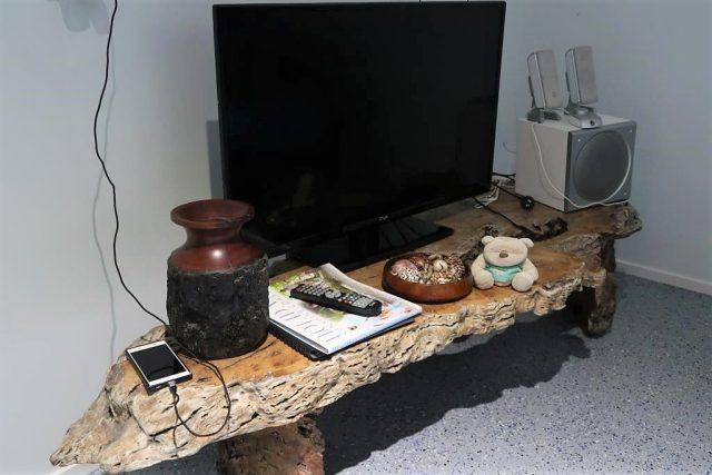 TV and Sofa at Moffatt Beach Accomodation