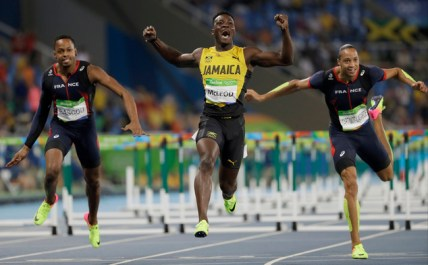 Jamaica's Omar Mcleod, center, wins the men's 110-meter hurdles final ahead of third placed France's Dimitri Bascou, left, and fourth placed France's Pascal Martinot-Lagarde during the athletics competitions of the 2016 Summer Olympics at the Olympic stadium in Rio de Janeiro, Brazil, Tuesday, Aug. 16, 2016. (AP Photo/David J. Phillip)