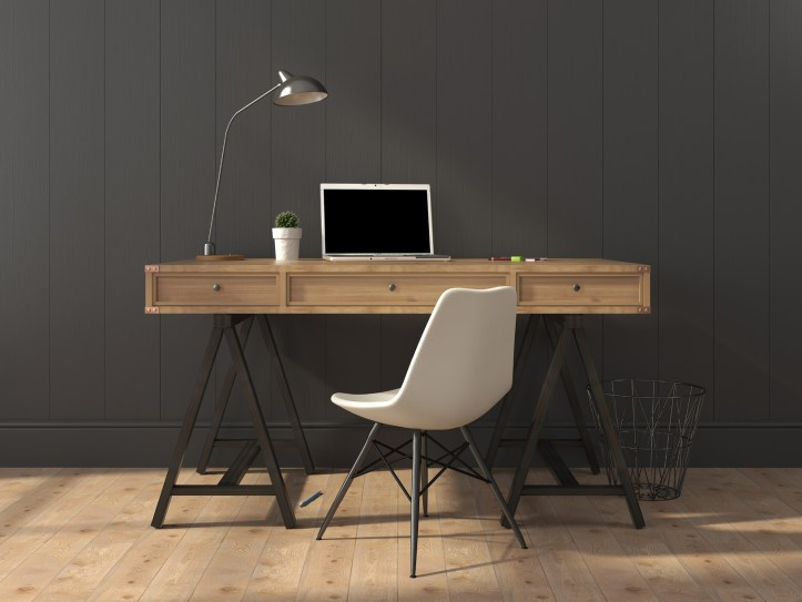 wooden desk with white chair and laptop