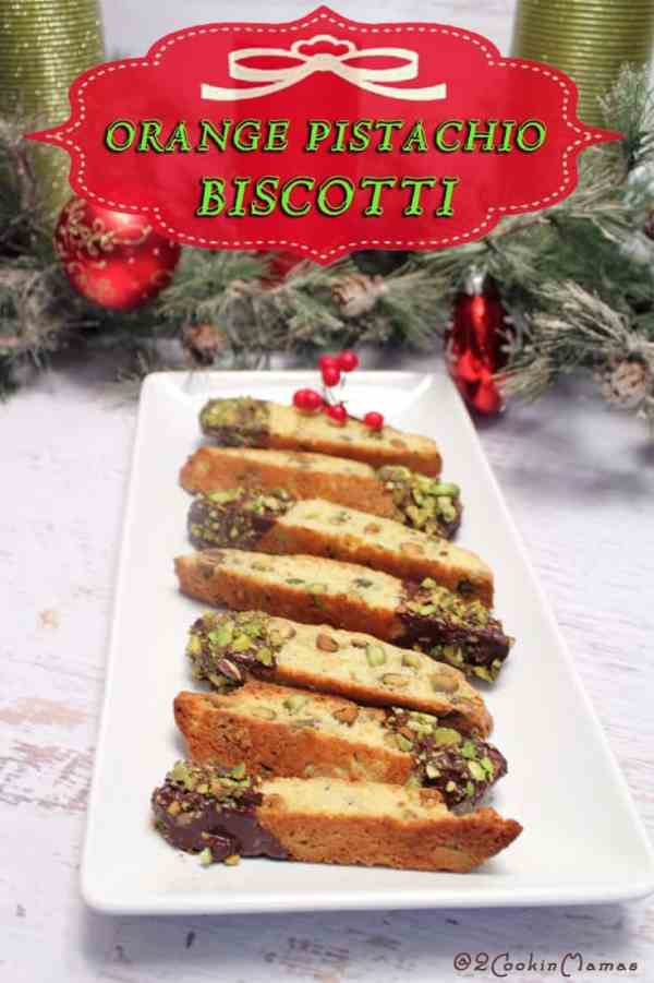 Orange Pistachio Biscotti |2CookinMamas - This cookie has tons of orange flavor, pistachios galore and better yet, dipped in chocolate with more pistachios! Great with coffee for a morning breakfast treat.