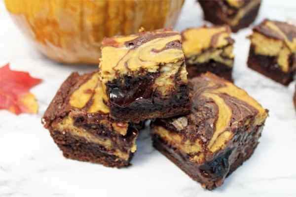 Pumpkin Cheesecake Brownies stack closeup 1 | Cookin Mamas