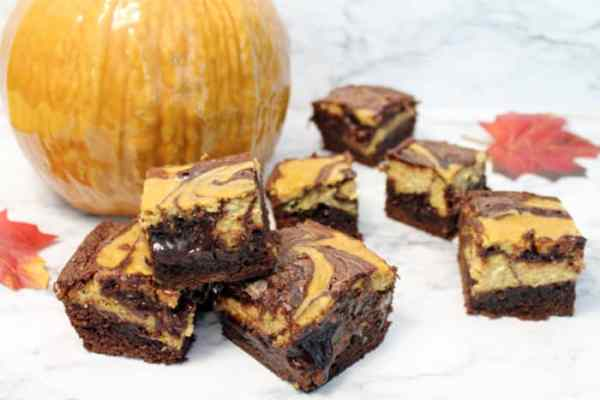 Pumpkin Cheesecake Brownies stacked | 2 Cookin Mamas