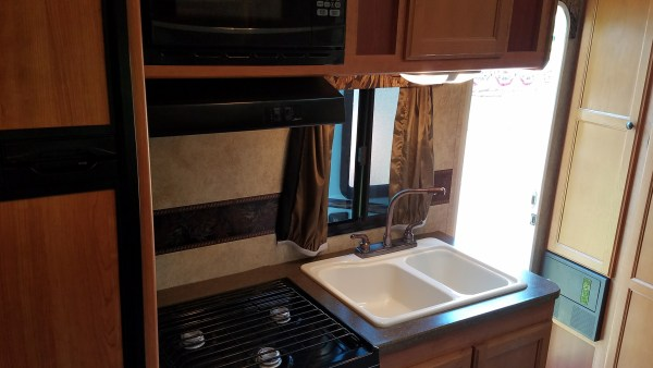 Full kitchen, sink, water, stove