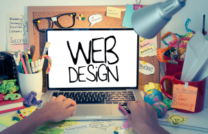 """The words """"web design"""" on a computer screen with hands typing"""