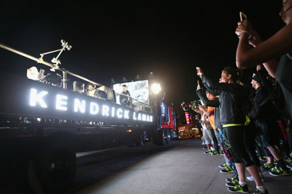A truck with an open trailer carried Kendrick Lamar across West Hollywood as he performed songs from two of his albums.