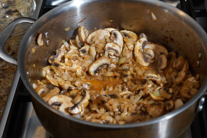Mushrooms and onions browning in preparation for wild rice and mushroom soup.