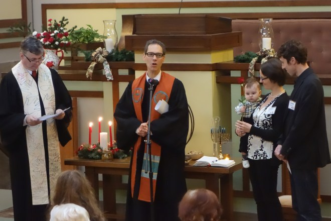 Jurgen holding the rose presented by  Rev. Alan Taylor at the dedication. With Associate Pastor Rev. Scott Talbot Lewiis, Henriët and Andrew