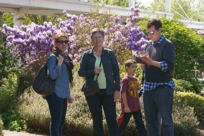 Sarah, Carla, unknown kid, and Jeff pondering options at the Seattle Center