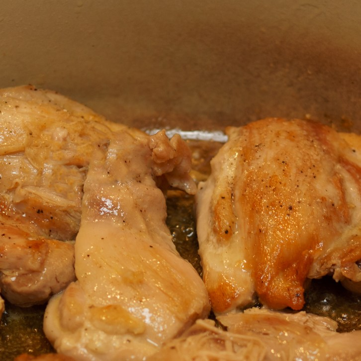 Slow cooker chicken tortilla soup step 1: brown the chicken thighs.