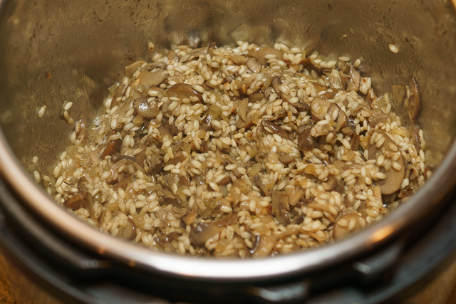 Mushrooms, onions, and rice for mushroom risotto just about ready for the liquids and 5 minutes of pressure cooking