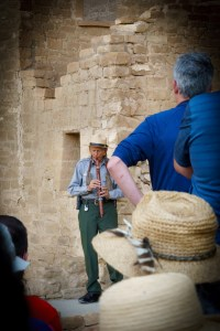 Our National Parks tour guide playing a homemade flute at Cliff Palace