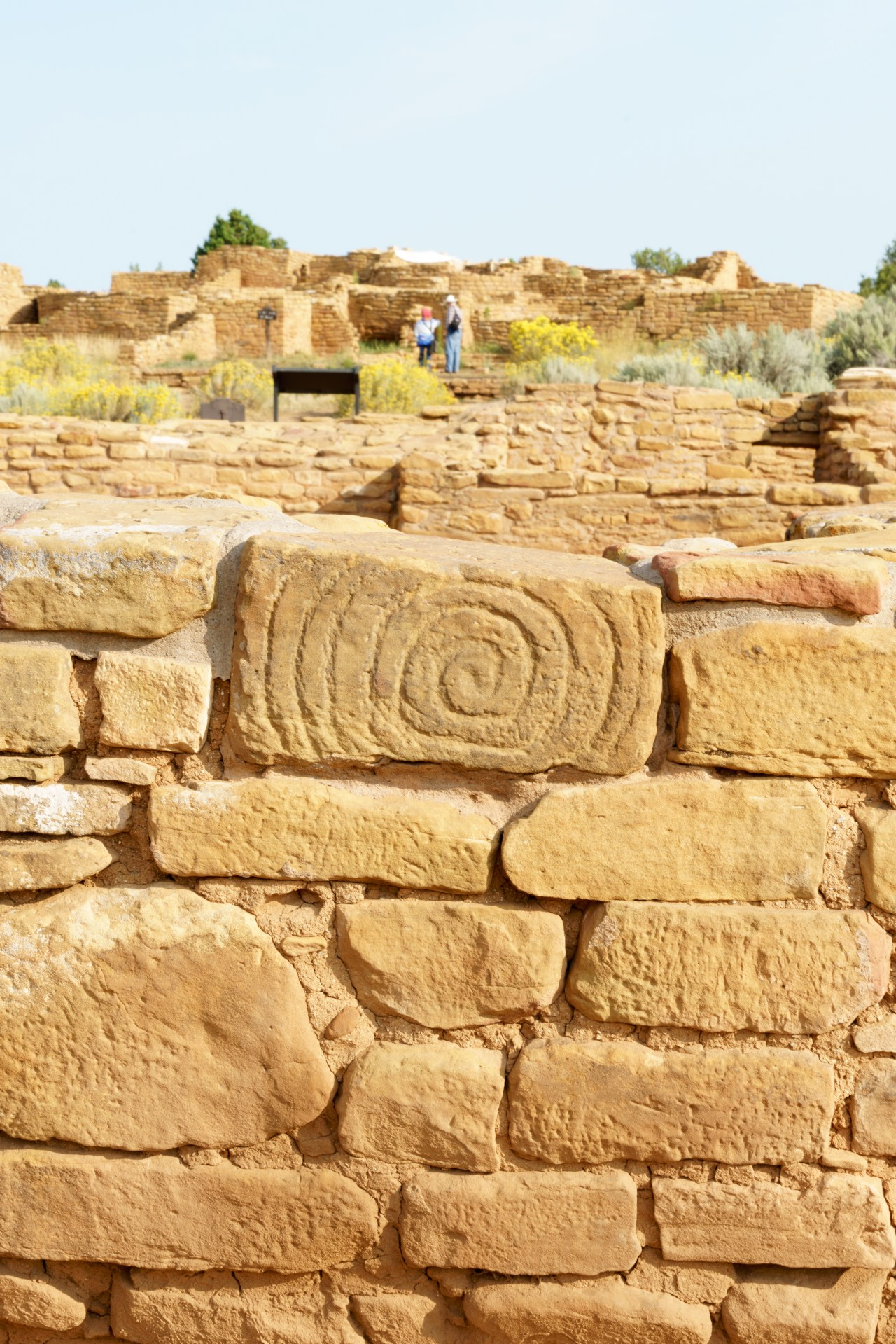 Close up of art work on a brick in Mesa Verde building