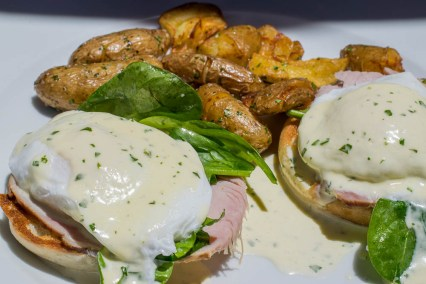 Gertrude's Gertie's Benedict is topped with house made Canadian bacon, spinach, poached eggs and Tabasco hollandaise
