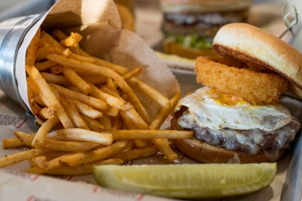 Try a beastly burger with a fried egg and onion ring at Burger Theory