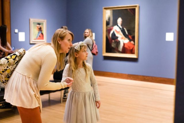 museum-goers inside the Oklahoma City Museum of Art peruse the gallery