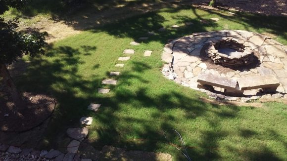 new sod with stepping stones and custom fire pit