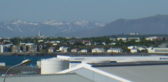 here's with some zoom - Hallgrimskirkja poiny on the left, the Pearl roundy on the right