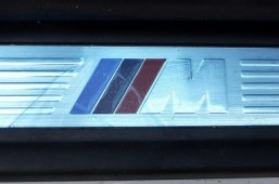 MSport badge on the BMWs sill.