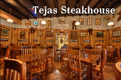 The dining room at the Tejas Steakhouse and Saloon is made complete with authentic western decor.