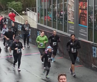Somehow we're still smiling--oh, it's because the finish line is about 100 feet ahead!