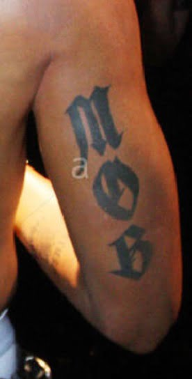 Tupacs Tattoos What Is The Meaning Of 2pacs Tattoos