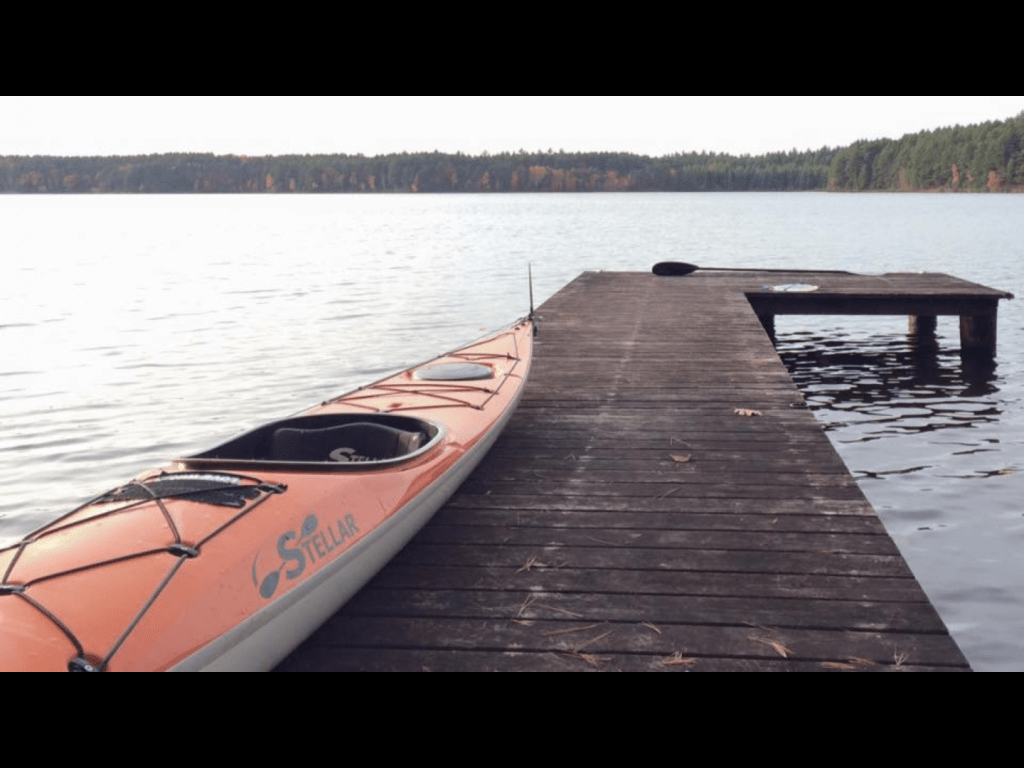 Orange Stellar Kayak on pier.