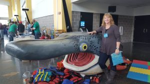 Peggy Gabrielson and the Canoecopia fish.