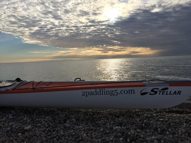 Joe Zellner's 2 Paddling 5 Stellar kayak on a Lake Michigan beach.
