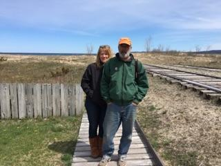 Joe and Peggy on boardwalk by railroad tracks near Leelanau State Park, Michigan. .