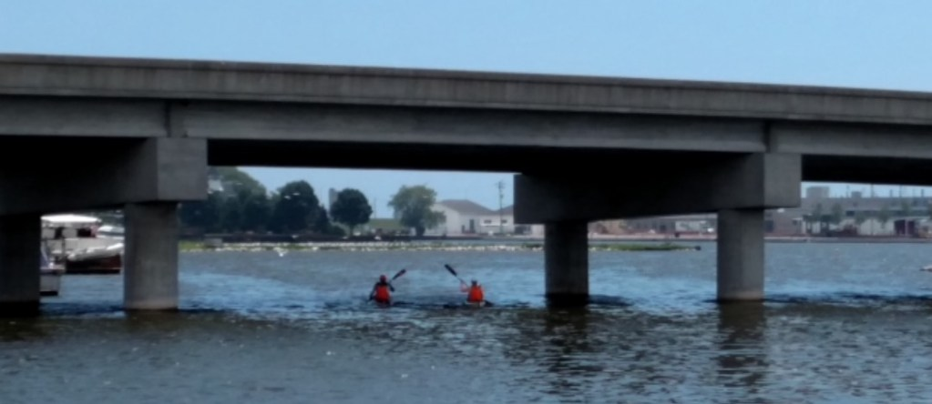 Kayaking out at Kewaunee, Wisconsin under a bridge.