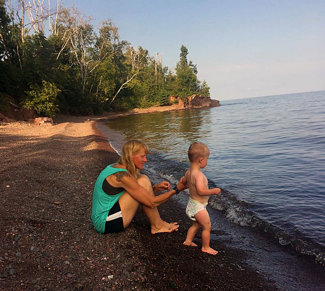 Peggy Gabrielson with her Grandson Brock on a Lake Superior beach.