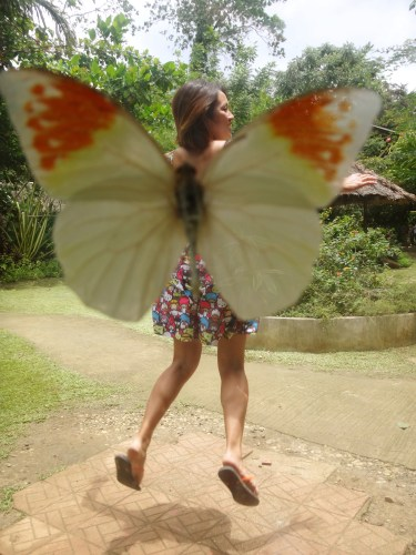 "Cheesy ""I'm flying!"" butterfly photo."