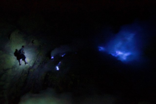 A hiker approaching the famous blue flame.