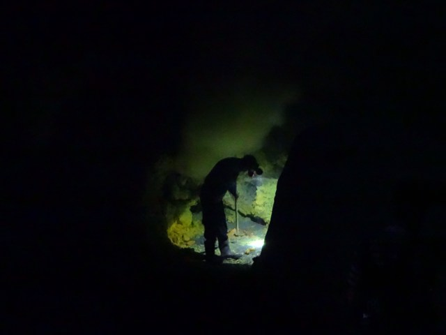 A sulphur miner in the dark.