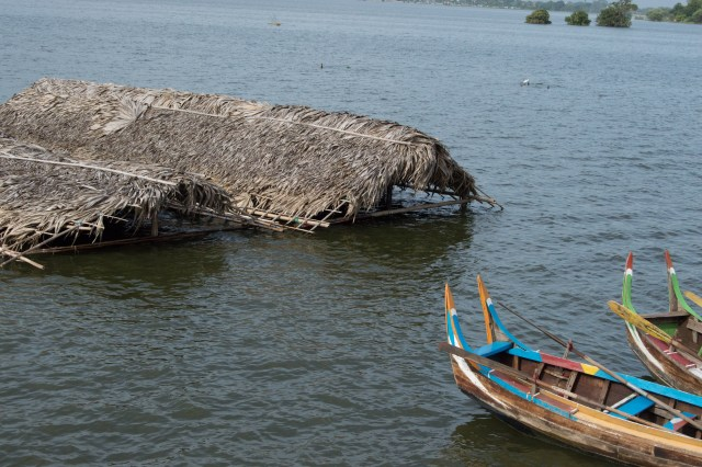 Huts covered by high water at U Bein Bridge.