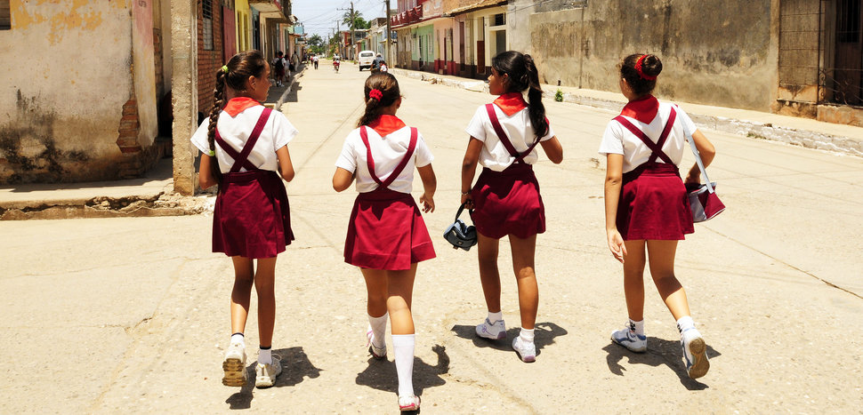 (GERMANY OUT) Cuba Santiago de Cuba - Trinidad: school girls waering school uniform on the way home - 01.06.2009 (Photo by Konzept und Bild/ullstein bild via Getty Images)