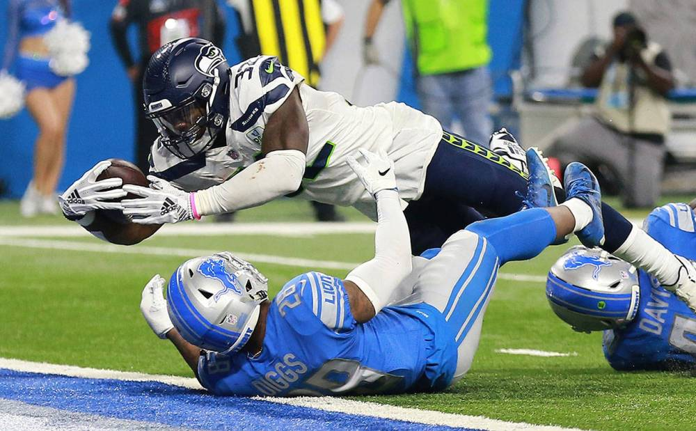 Image result for chris carson lions