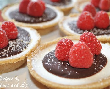 Mini Panna Cotta Tarts with Lingonberries and Chocolate. by 2sistersrecipes.com