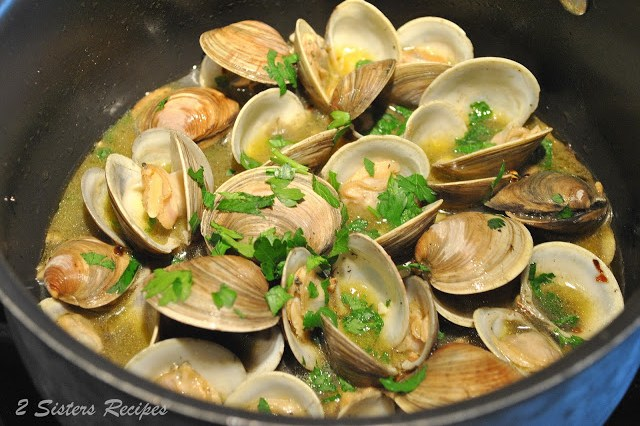 Little Neck Clams steaming inside a pot. by 2sistersrecipes.com