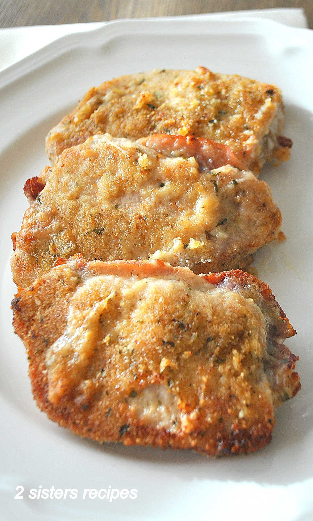 Baked Stuffed Pork Chops with Prosciutto and Cheese by 2sistersrecipes.com