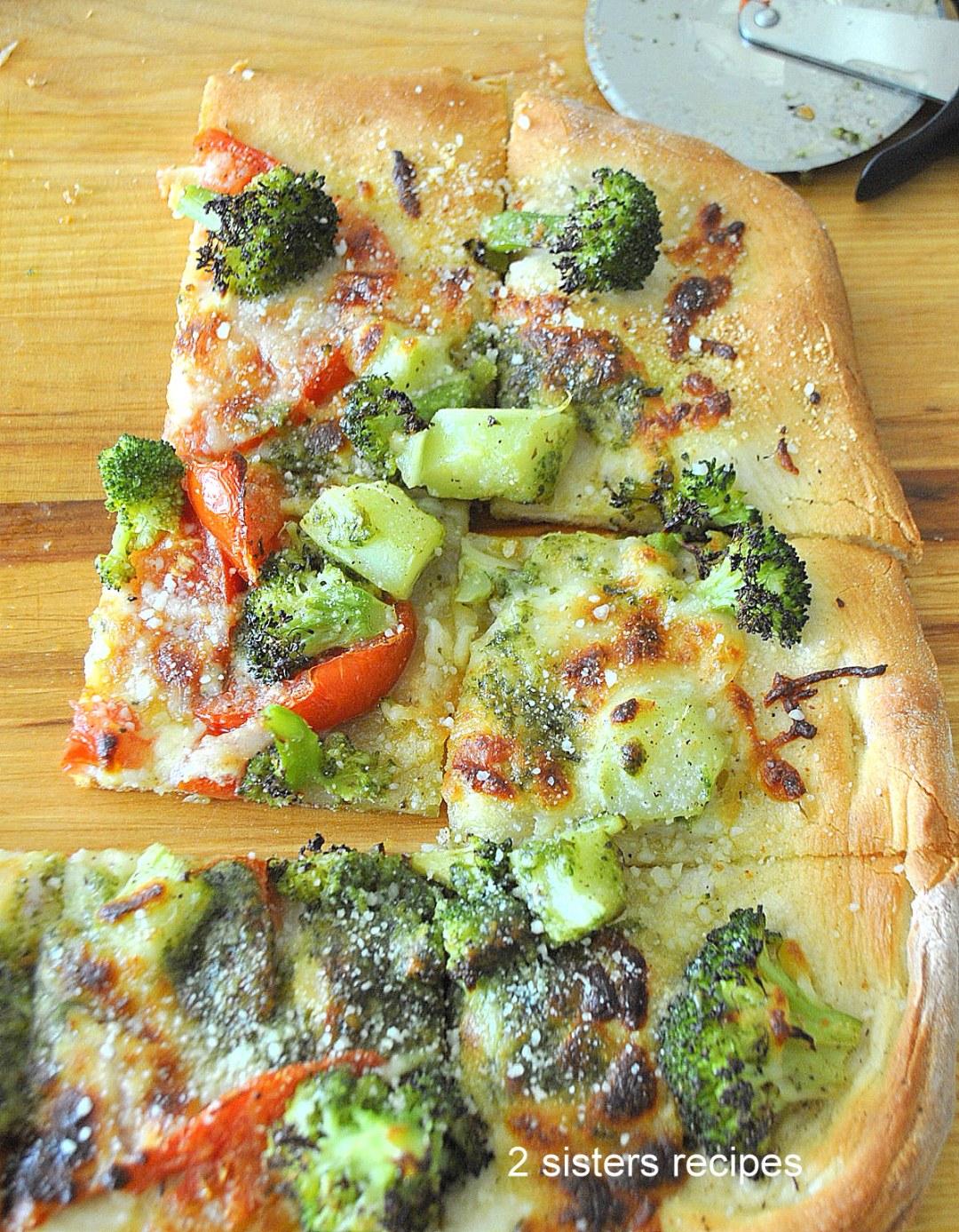 Broccoli Tomato Pesto Pizza by 2sistersrecipes.com