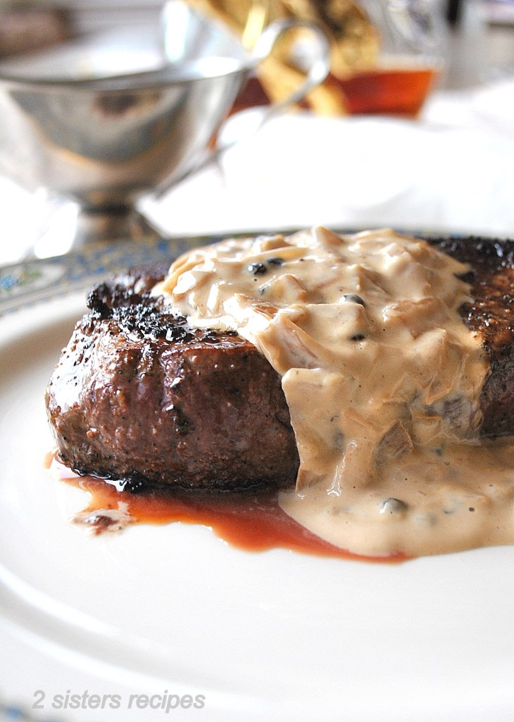 Filet Mignon with Cognac Peppercorn Sauce by 2sistersrecipes.com