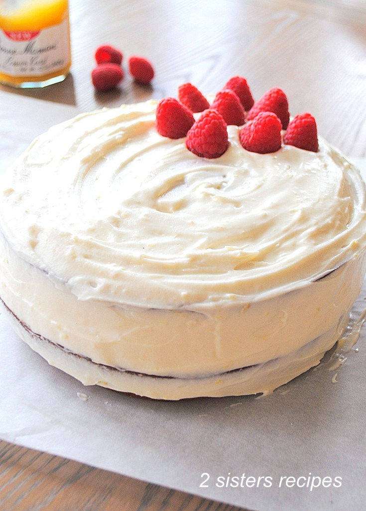 Bakery-Style Lemon Raspberry Cake by 2sistersrecipes.com