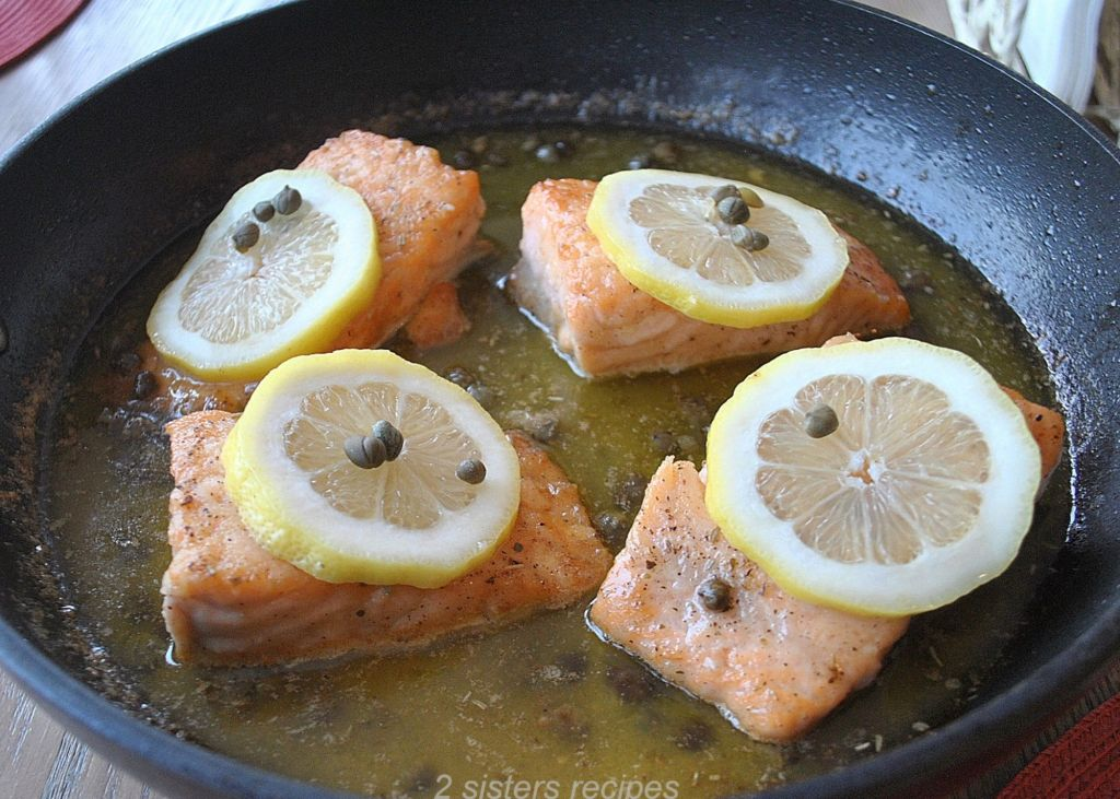 photo of salmon in a skillet by 2sistersrecipes.com