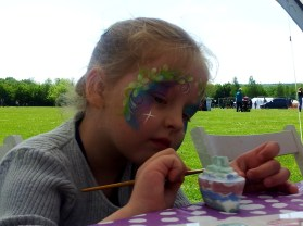 A painted face painting pottery