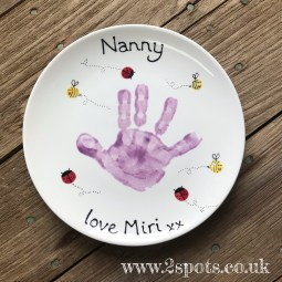 Painted Plate with fingerprint creatures