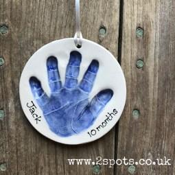 Clay ornament in dark blue
