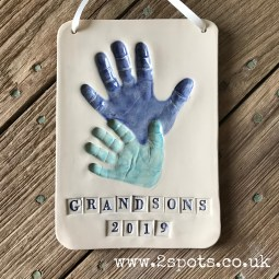 Grandsons clay handprints in blues
